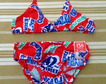 4da88df6f7bc9 French Highly Collectible 1970s Girl Vintage Bikini Bathingsuit Swimsuit  Swimwear - Classic American Movies Print - New & Tag - 10 years