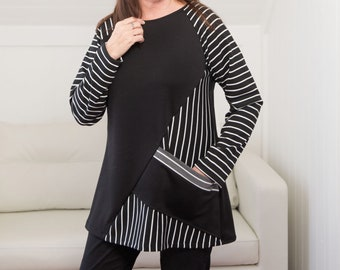 Small to 1X Womens black and white striped tunic knit top with diagonal pocket. .