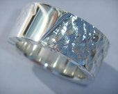 Handmade Chunky Silver Ring with a Angel Wing Design. Perfect Silver Wedding Band