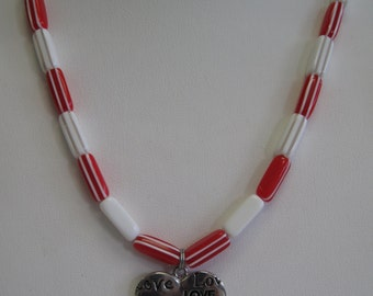 Red and white or red and pink Valentine heart necklace.