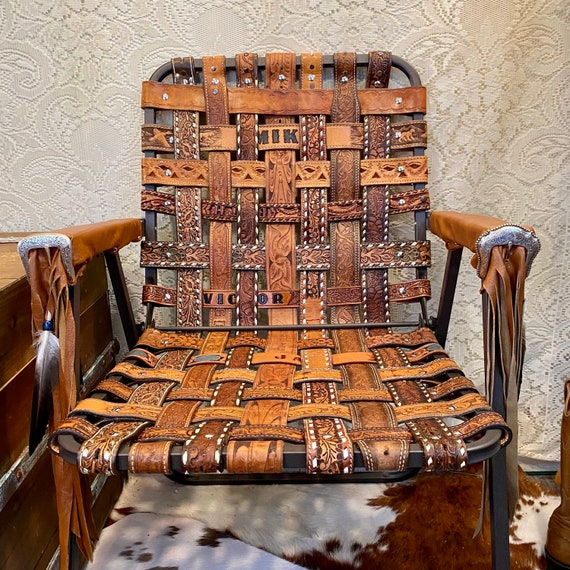 Handcrafted Western Leather Folding Chair made from vintage leather belts with Fringe and Feathers