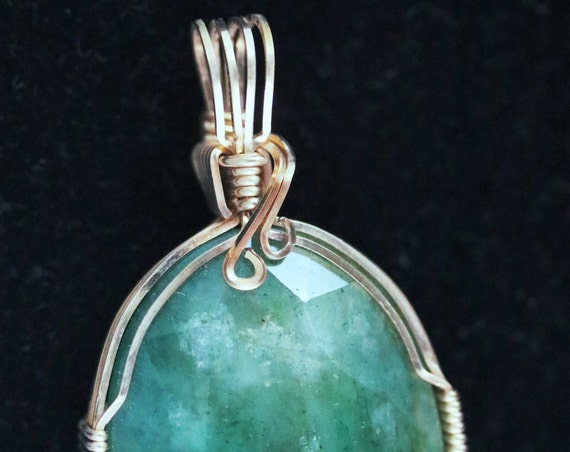"Emerald pendant, green gem, ""Green Sheen"", gold wire wrap 46.5ct"