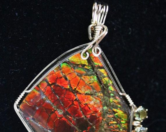 "Ammolite (Opal) pendant, red orange green black, free-form, ""Flaming Gorge"", Peridot gemstones 55ct"