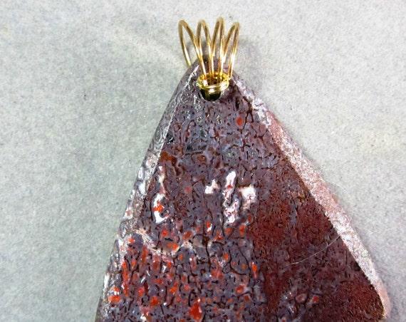 Dinosaur Bone Pendant, fossilized brown red, brass bail 100ct