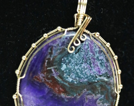 "Sugilite pendant, purple peach blue, ""Heavenly Horizon"", gold wire wrap 82.5ct"