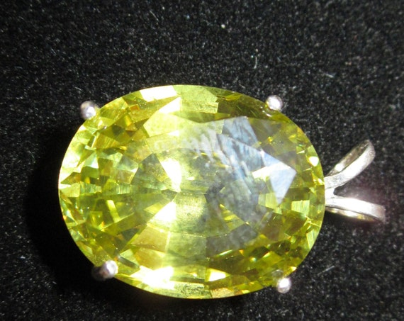 Olive Green Gemstone Pendant, faceted gemstone, silver bezel 55ct