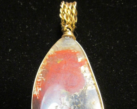 "Coprolite pendant, dinosaur dung, red beige tan gray translucent, ""Pterdactyl Chopper"",  brass wire wrap 115ct"