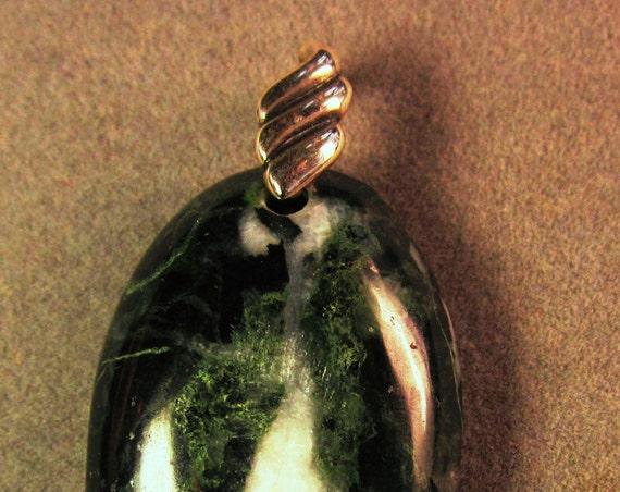 Jade pendant, Jadeite oval, silver wavy bail 62ct