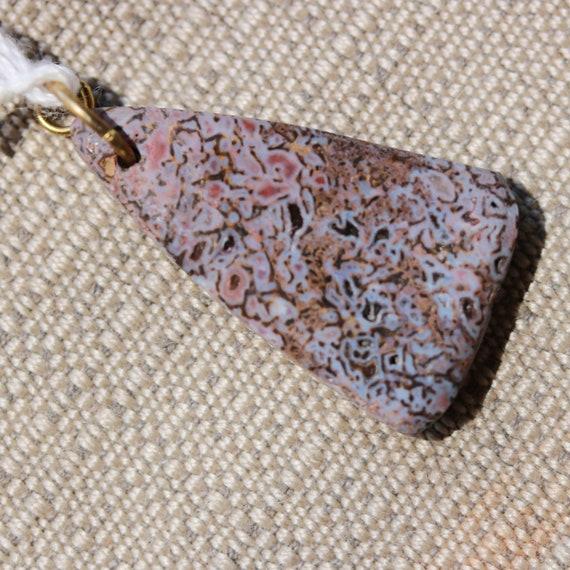 Dinosaur Bone Pendant, fossilized, brown black, brass bail 22ct