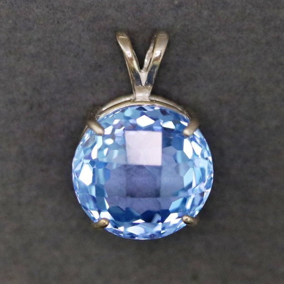 Topaz pendant, faceted sky blue, December Birthstone, silver bezel 35.5ctg