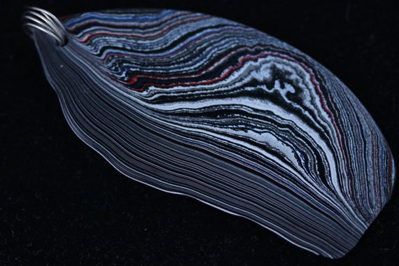Fordite pendant nickel twirl bail black silver red 26.5ct