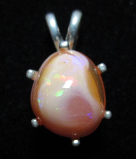 Opal pendant in matrix on silver bezel 16.4ct