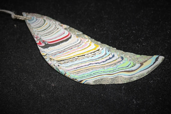 """Fordite pendant multi-colored, """"Sweeping Scythe"""", silver twisted twirl bail 26ct"""