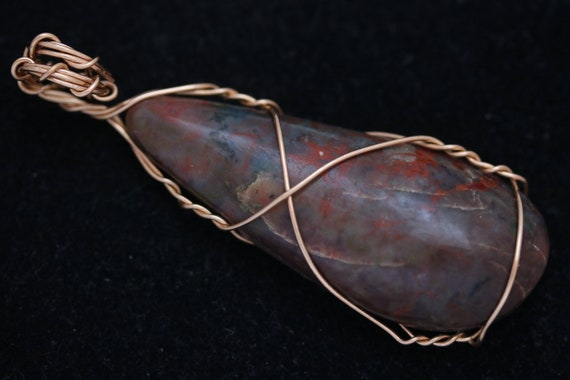 Coprolite pendant, brown rusty red, brass wire wrap 75ct