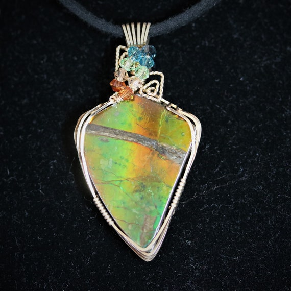 Ammolite (Opalized Ammonite Shell) pendant, gold green, Gold Wire Wrapped, 9 faceted gemstones 34ct