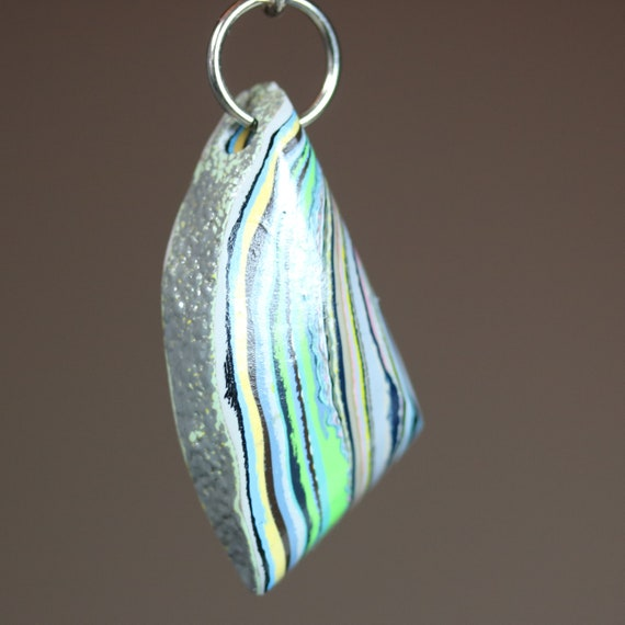 """Fordite pendant, """"Curved Right"""", green black yellow, silver jumps bail, 33ct"""
