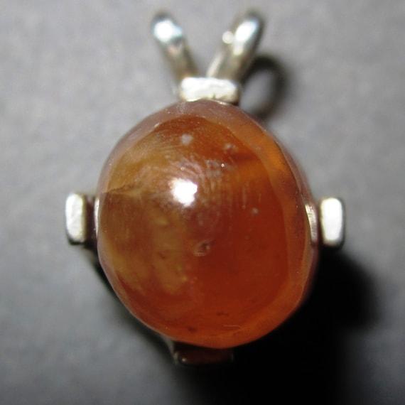 Spessartite pendant, orange, Garnet Cabochon, silver bezel 38ct