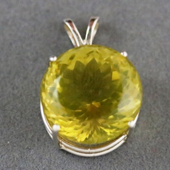 "Lemon Quartz pendant, dark yellow, ""Swirling Star"", 4 point silver bezel 40ct"