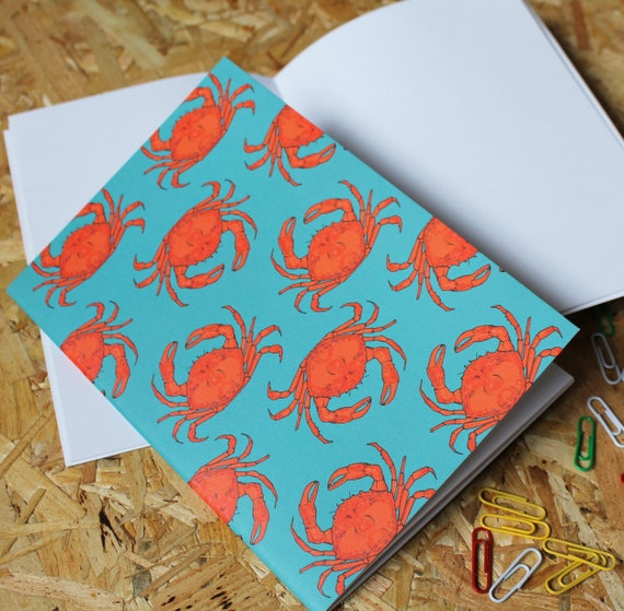 Crab A5 Notebook with 40 blank pages.