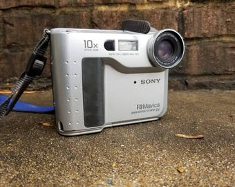 Digital Camera with Floppy Disk Storage Slot