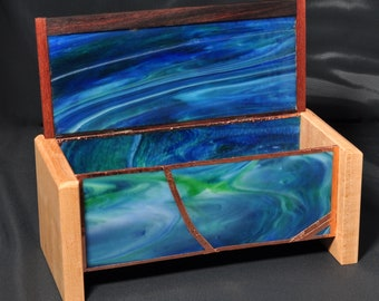 Green Swirly Glass Box with copper embellishments. The top is made of Curly maple, Bolivian rosewood and Lacewood.