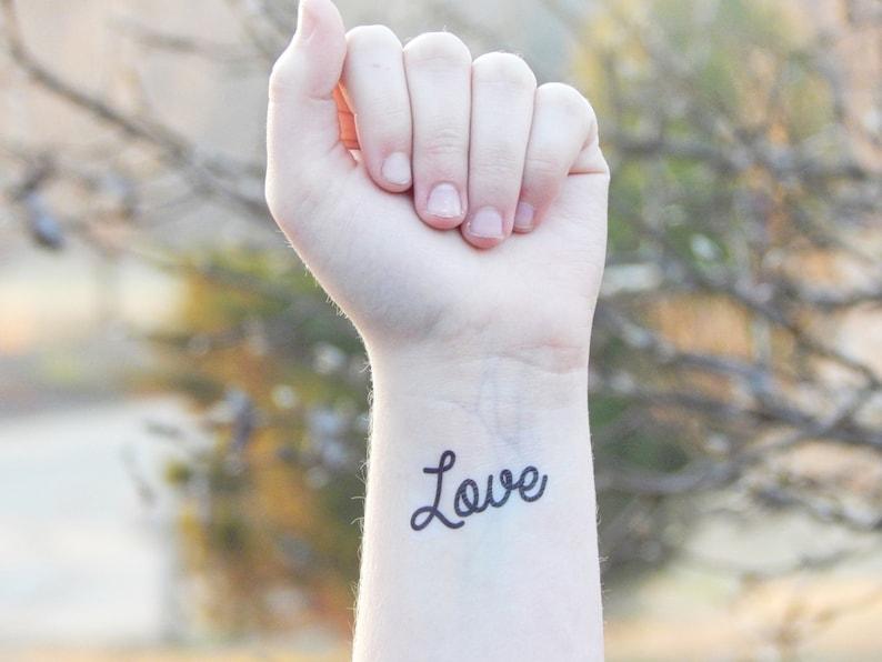 cc285a08196bd Love Tattoo Temporary Tattoo script cursive tattoo fake | Etsy