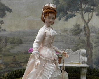 Lovely porcelain dollhouse doll, Victorian young lady dressed in pale pink silk