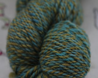 100% pure wool, hand spun to a DK weight in greens and blues. 98gms