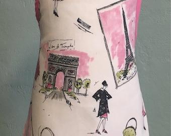 Cream Paris kids apron with pink trim and ties