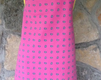 Pink paisley apron with yellow trim and ties