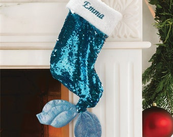 Whimsical Christmas stockings shaped like mermaid tails in green or pink velvet with matching sequins and can be personalized