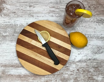 Nine inch round Cherry and Maple cutting / serving board