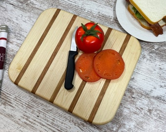 Maple and Cherry cutting board. Hand made and made to be used