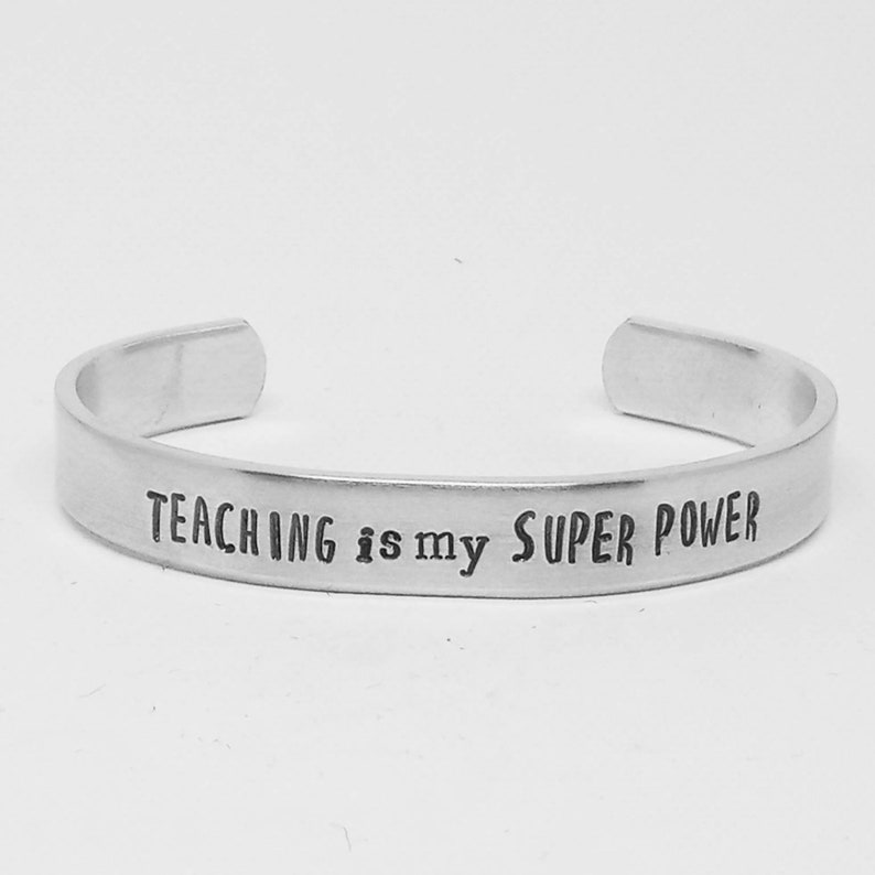 Teaching is my super power: hand stamped aluminum cuff image 0