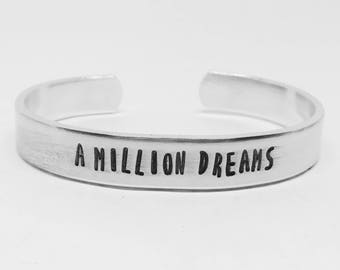 A million dreams : Hand Stamped Aluminum Greatest Showman P. T. Barnum circus movie musical quote cuff by fandomonium