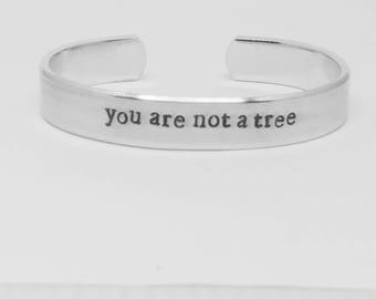 You are not a tree: hand stamped aluminum reminder motivational or inspirational gift cuff bracelet