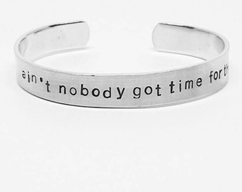 ain't nobody got time for that: hand stamped aluminum cuff bracelet