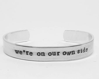 We're on our own side: Good Omens-inspired hand stamped fanperson/ fangirl/fanboy cuff