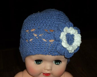 Periwinkle beanie with a large white flower