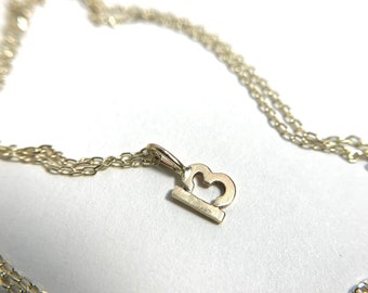 Number charm necklace in 14k gold