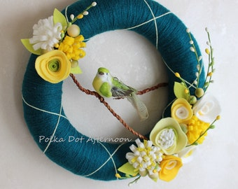 Peacock Yarn Wreath with Yellow Felt Flowers and Green Bird 10""