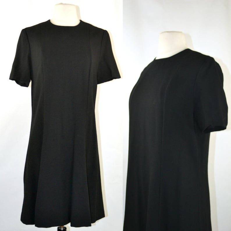 1960s Simple Classic Black Princess Cut Short Sleeve Dress by image 0