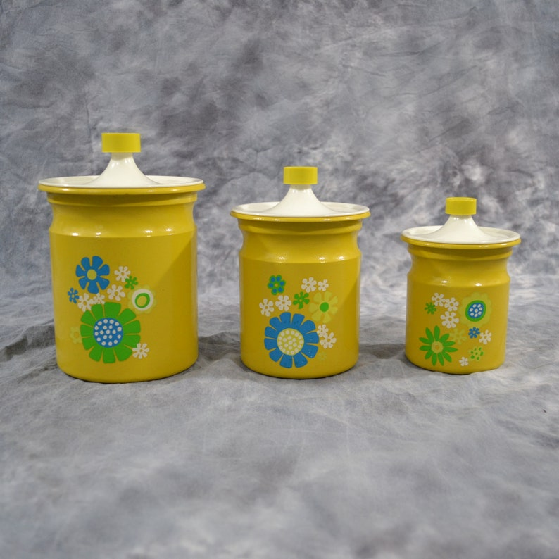 1960s/1970s Three Yellow Flowered Stackable Metal Canister Set image 0