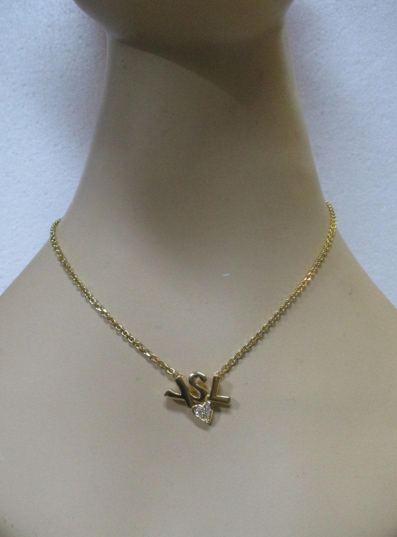 b3dc69d927d Vintage YSL Logo and Heart Necklace image 0 ...