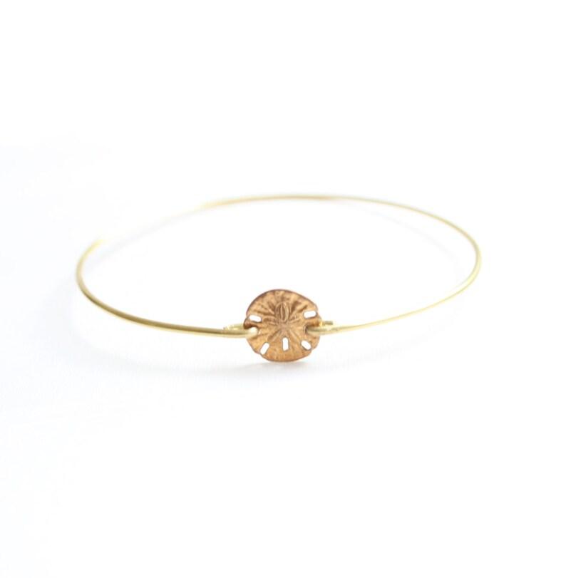 9bede3dd376 Tiny Sand Dollar Bracelet Ocean Bracelet Beach Bracelet | Etsy