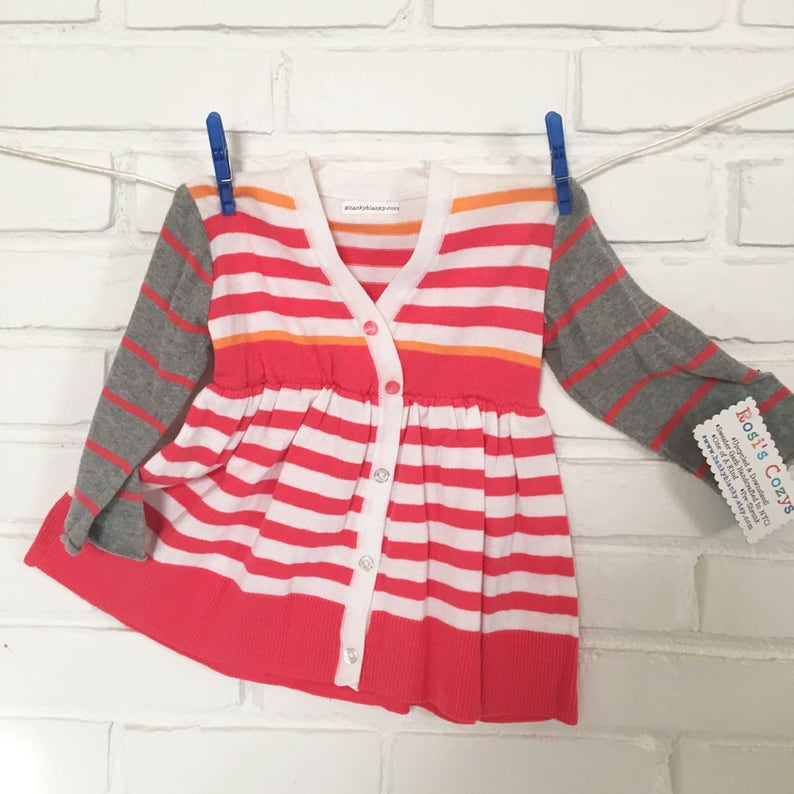 da76aa731e A pink white striped sweater dress for toddlers cut from