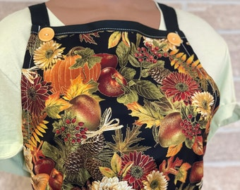 Fall apron filled with pumpkins, flowers and leaves