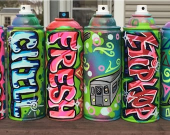A Personalized spray paint can with the name and color of your choice.