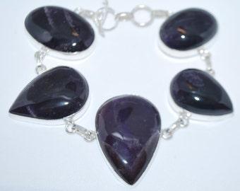 Dogtooth Amethyst gemstone crystal bracelet with healing properties present birthday