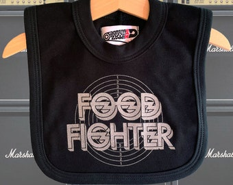 Foo Fighters pun baby bib - Food Fighter! Cool newborn baby gift for Dave Grohl fans. Alternative baby shower gift for new parents & rockers